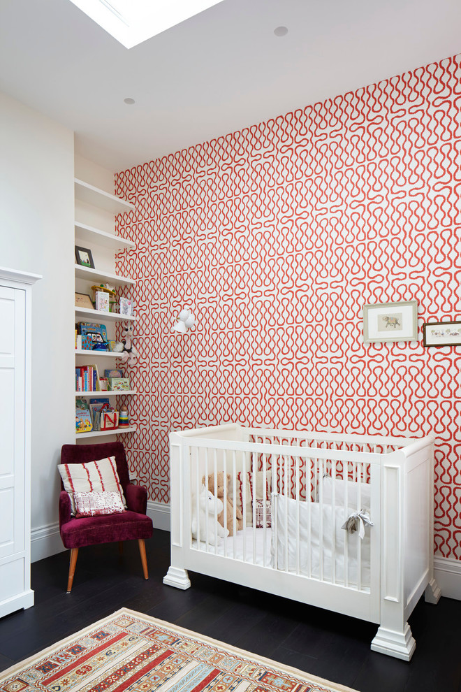 Nursery - contemporary gender-neutral black floor nursery idea in London with multicolored walls