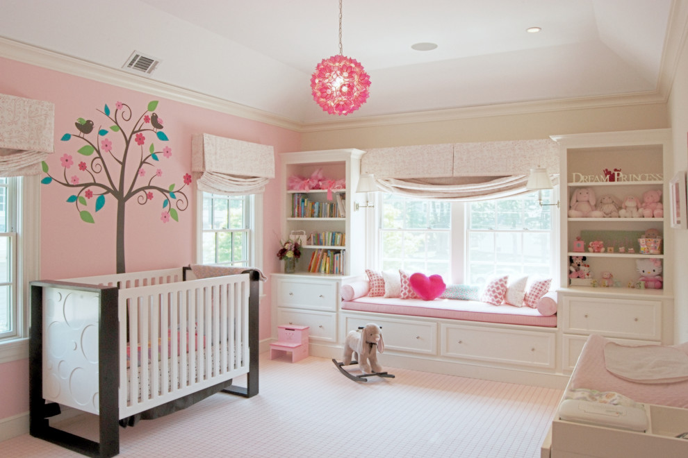 Large transitional girl carpeted and beige floor nursery photo in New York with pink walls