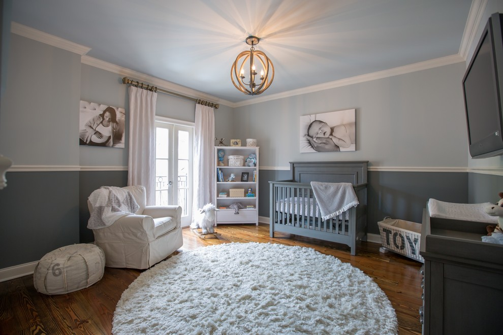 Design ideas for a transitional gender-neutral nursery in New Orleans with grey walls and medium hardwood floors.