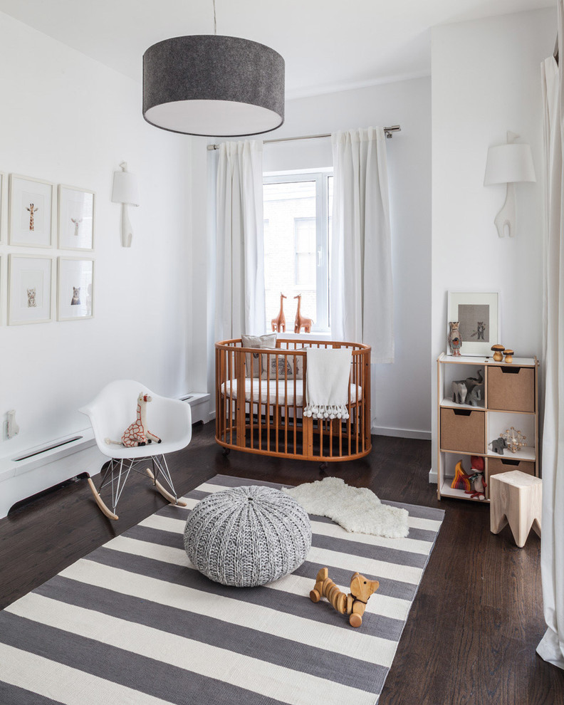 Inspiration for a mid-sized transitional gender-neutral dark wood floor nursery remodel in New York with white walls