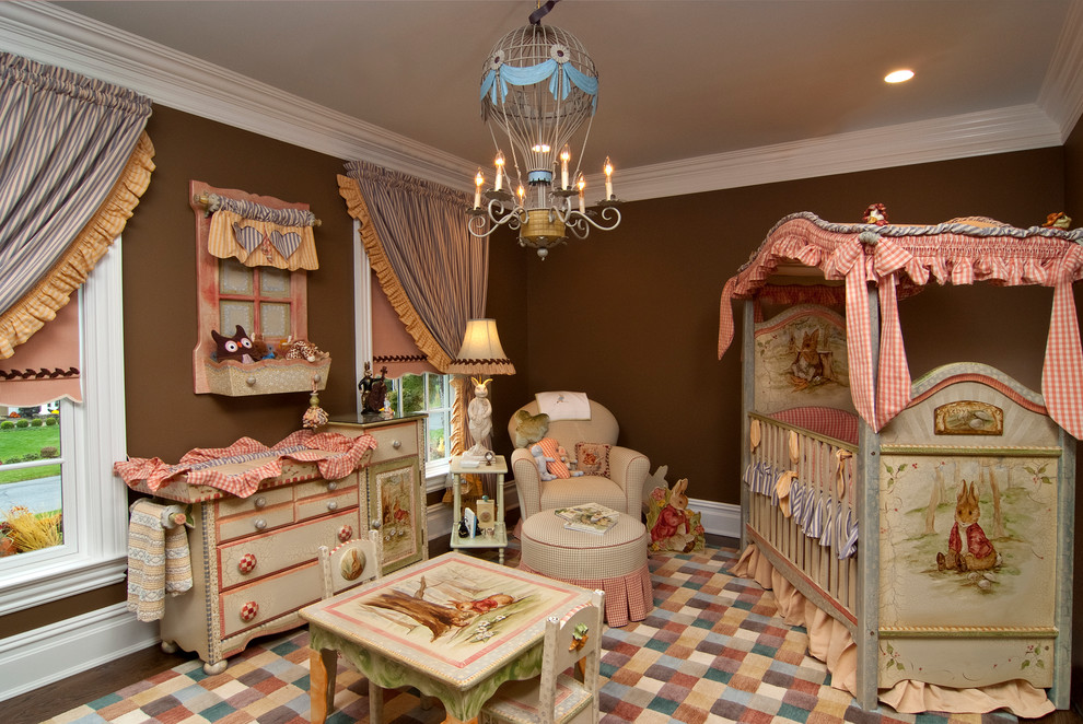 Example of a large classic girl nursery design in New York with brown walls