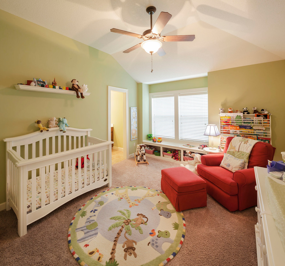 Mid-sized elegant gender-neutral carpeted nursery photo in Kansas City with green walls