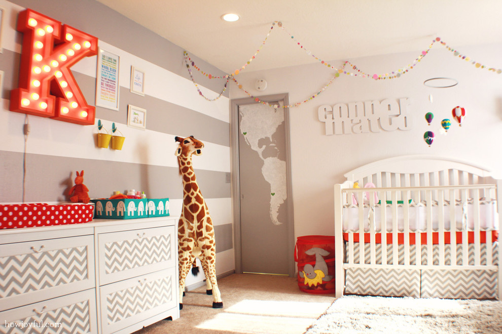 Example of a trendy gender-neutral carpeted nursery design in Orange County with gray walls