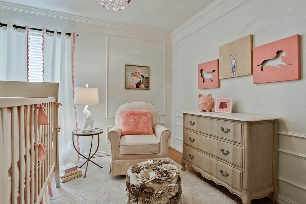 Inspiration for a timeless girl medium tone wood floor nursery remodel in Dallas with white walls