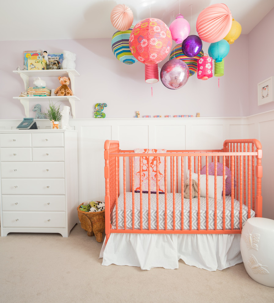 Nursery - mid-sized transitional girl carpeted and beige floor nursery idea in Calgary with purple walls