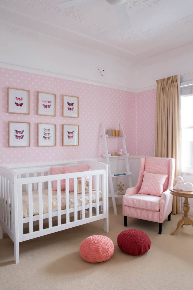 Example of a transitional girl carpeted and beige floor nursery design in Sydney with pink walls