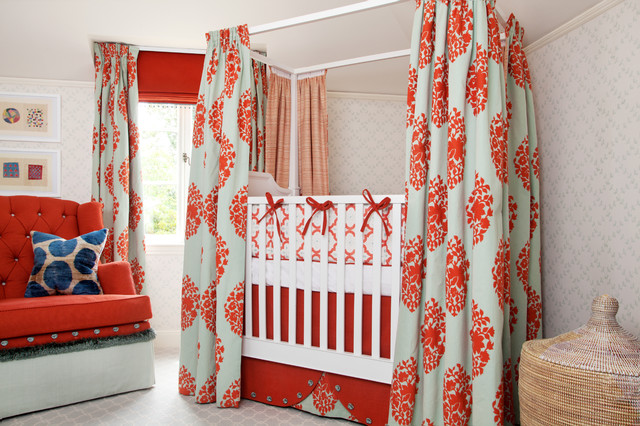 Example of an eclectic girl carpeted nursery design in San Francisco with multicolored walls
