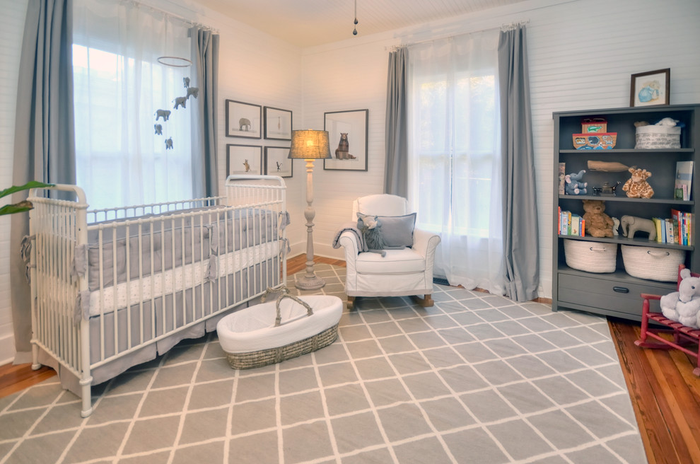 Inspiration for a mid-sized cottage gender-neutral medium tone wood floor and gray floor nursery remodel in Other with white walls