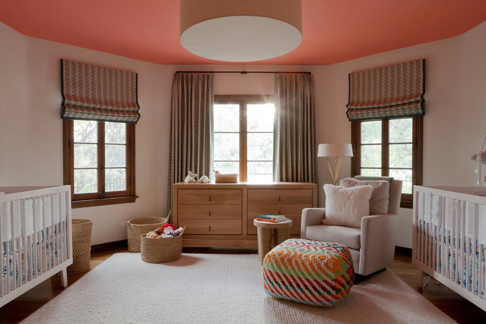 Nursery - transitional gender-neutral medium tone wood floor and beige floor nursery idea in Los Angeles with white walls