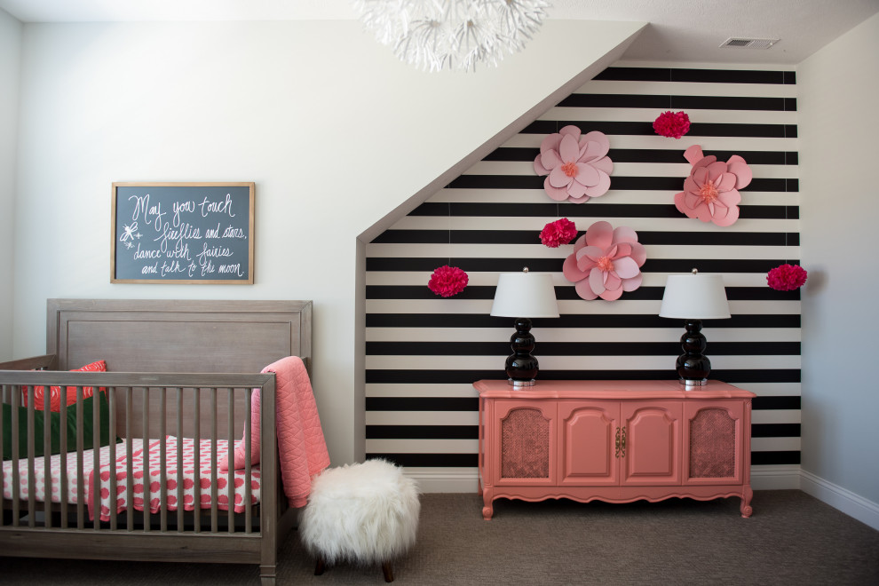 Example of a mid-sized trendy gender-neutral carpeted nursery design in Indianapolis with multicolored walls