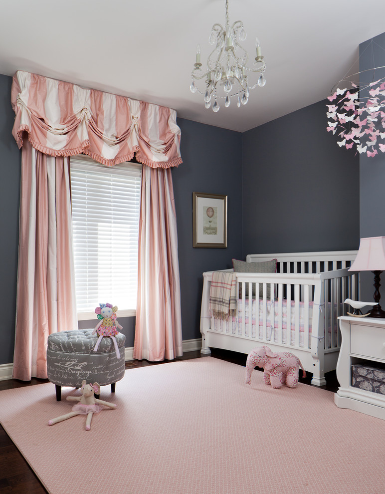 Nursery - mid-sized traditional girl nursery idea in Toronto with gray walls