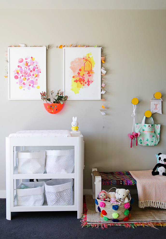 Design ideas for an eclectic gender-neutral nursery in Melbourne with black floor.