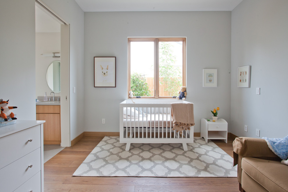 Trendy girl nursery photo in Los Angeles with gray walls
