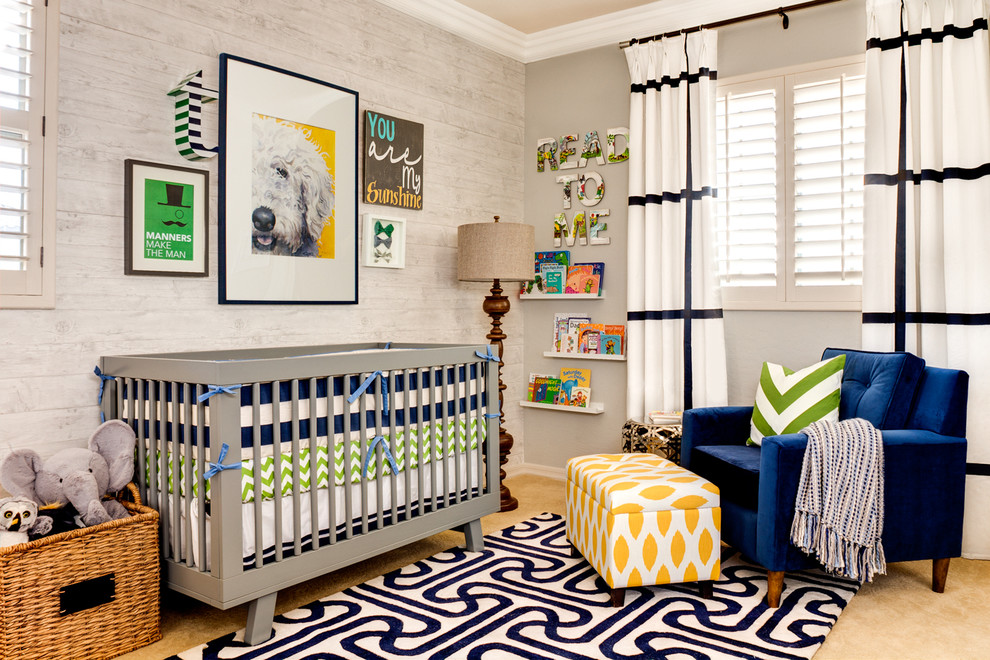 Trendy gender-neutral carpeted nursery photo in Phoenix with gray walls