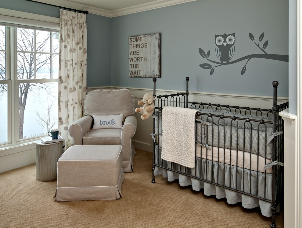 Example of a classic gender-neutral carpeted nursery design in Minneapolis with blue walls