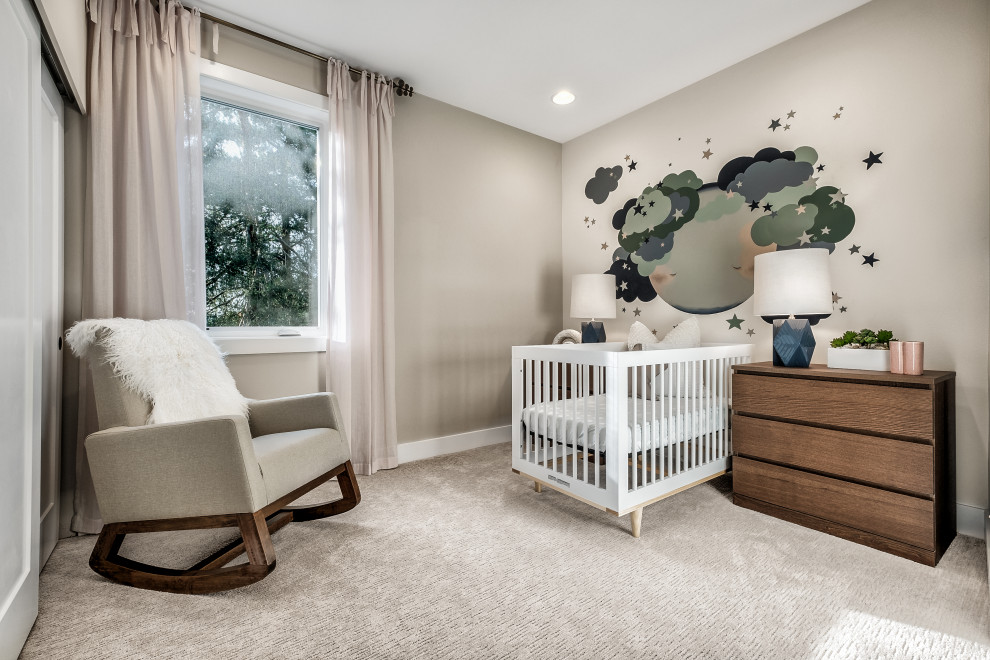 Example of a trendy gender-neutral carpeted and beige floor nursery design in Seattle with beige walls