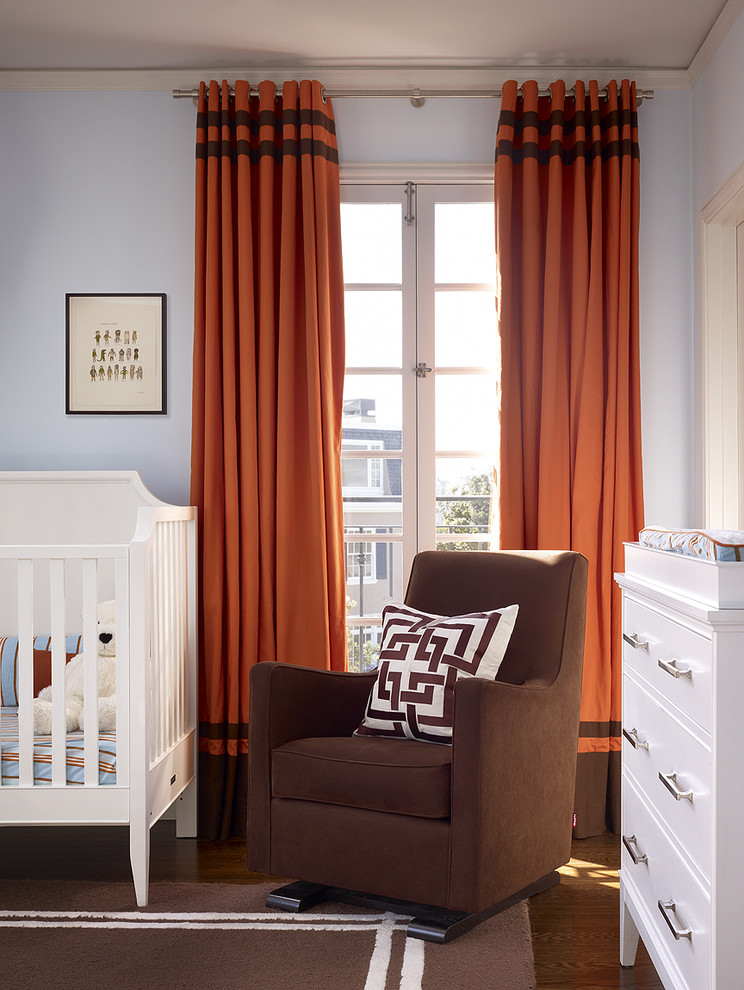 Inspiration for a timeless gender-neutral medium tone wood floor nursery remodel in San Francisco with blue walls