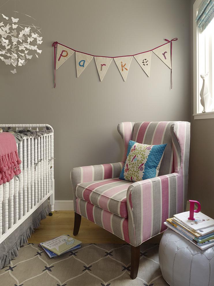 Nursery - small transitional girl light wood floor nursery idea in San Francisco with gray walls