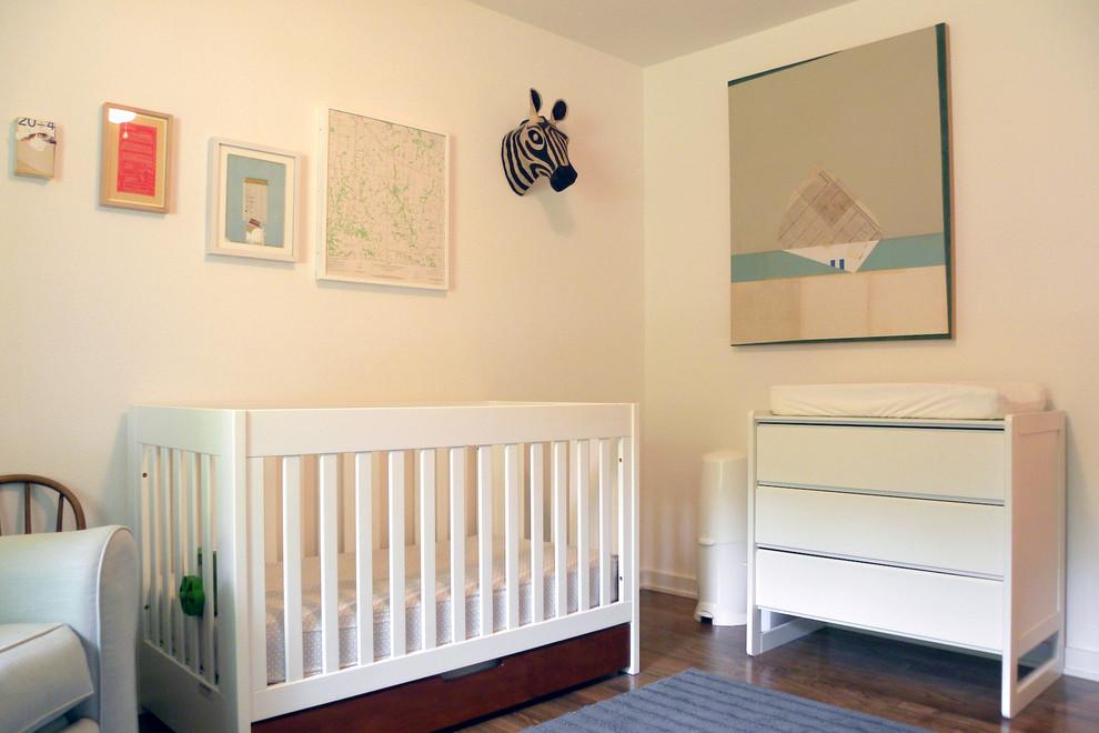 1950s gender-neutral dark wood floor nursery photo in Dallas with white walls