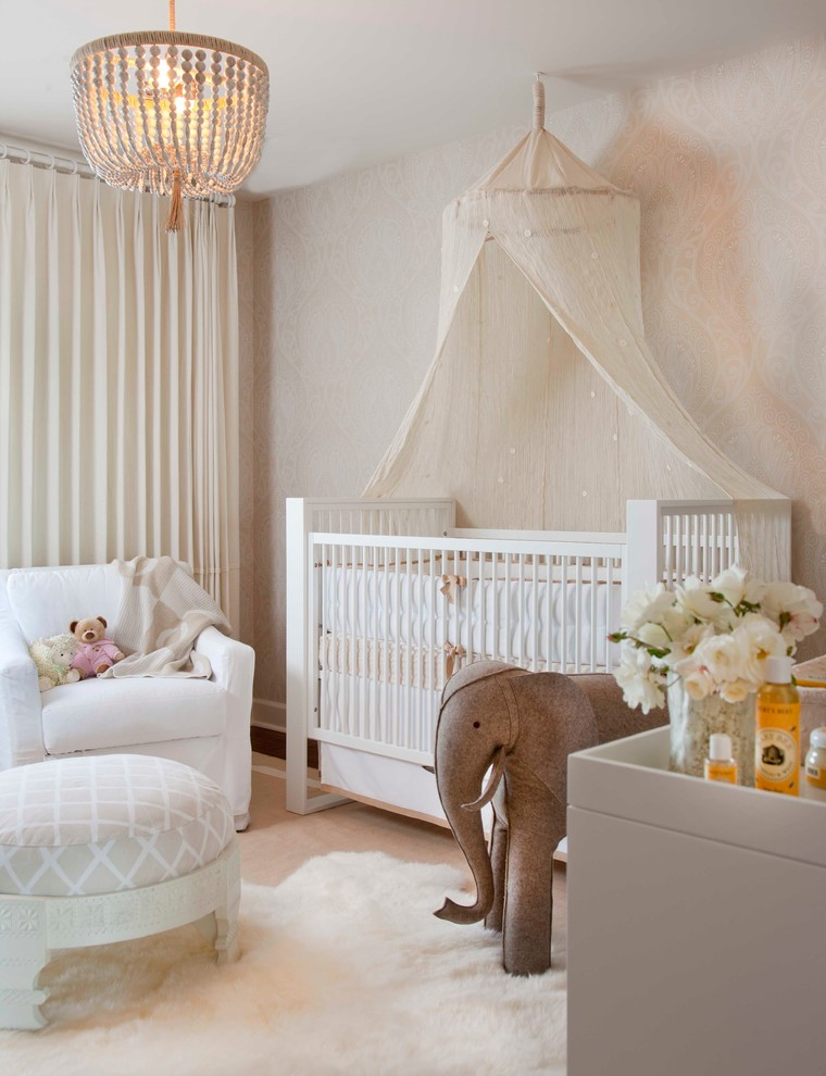 Example of a transitional gender-neutral wallpaper nursery design in San Diego with beige walls