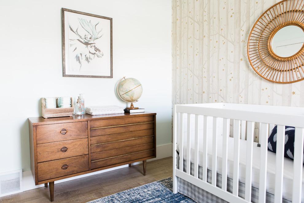 Small transitional boy light wood floor nursery photo in Salt Lake City with beige walls