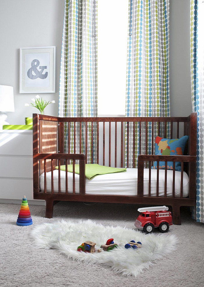 Elegant gender-neutral carpeted nursery photo in San Francisco with gray walls