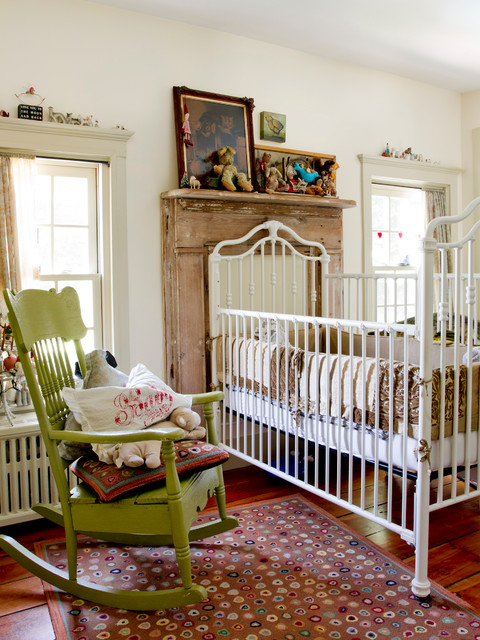 Inspiration for an eclectic gender-neutral medium tone wood floor nursery remodel in New York with white walls