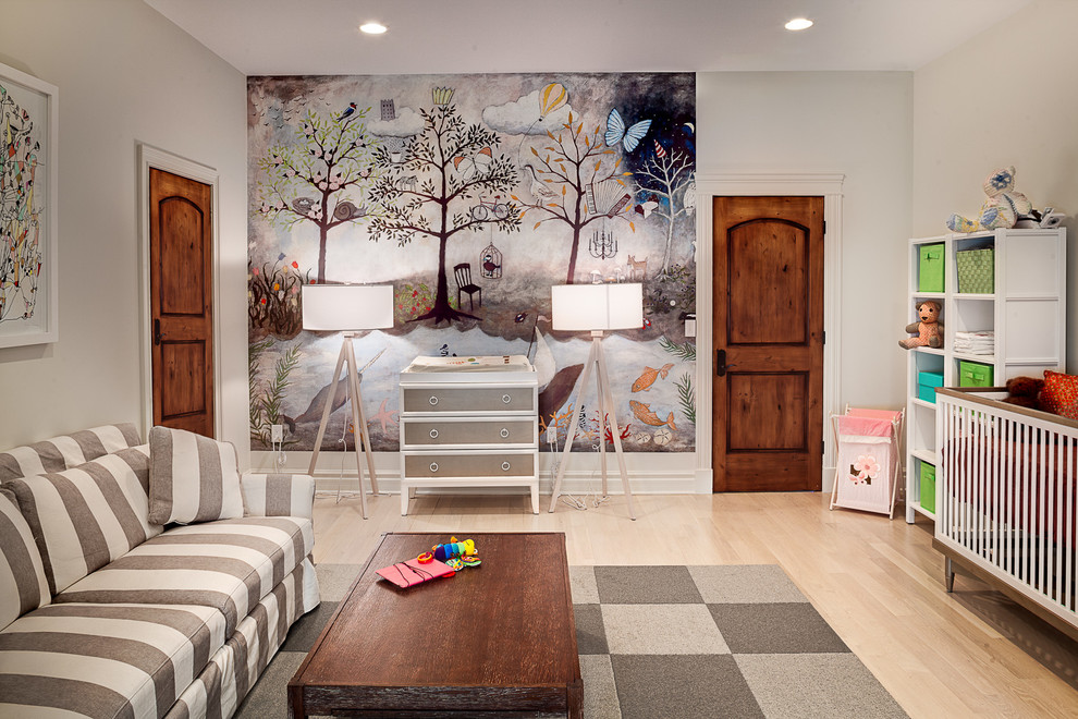 Nursery - large transitional gender-neutral light wood floor nursery idea in New York with gray walls