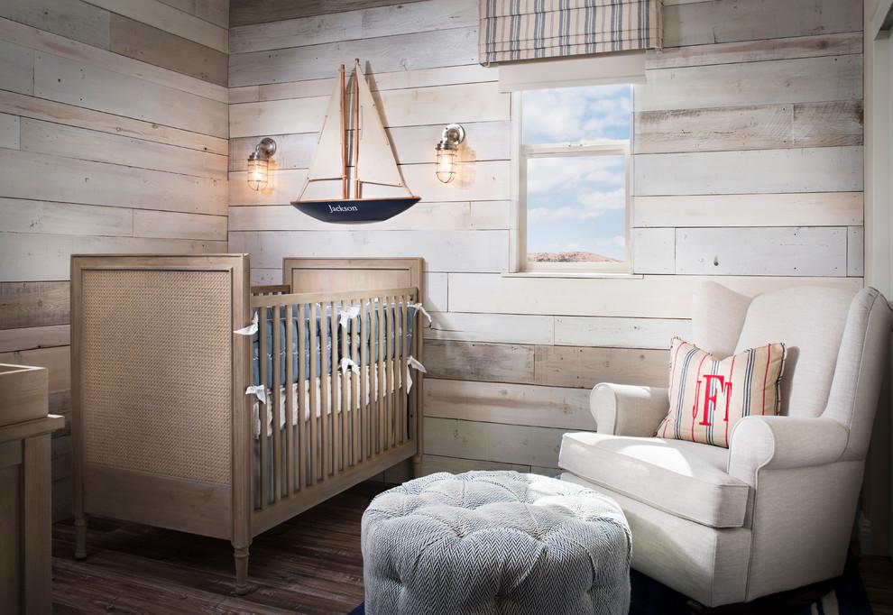 Nursery - small beach style gender-neutral medium tone wood floor nursery idea in San Diego with beige walls