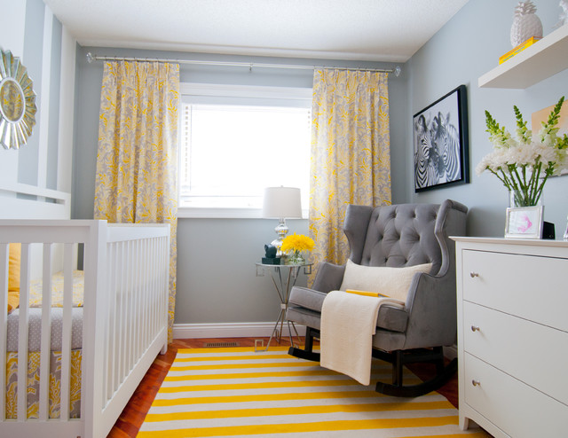 Inspiration for a small transitional gender-neutral medium tone wood floor nursery remodel in Calgary with gray walls