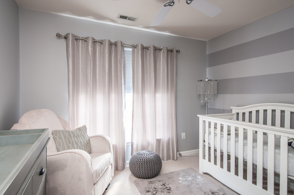 Nursery - traditional girl carpeted nursery idea in DC Metro with gray walls
