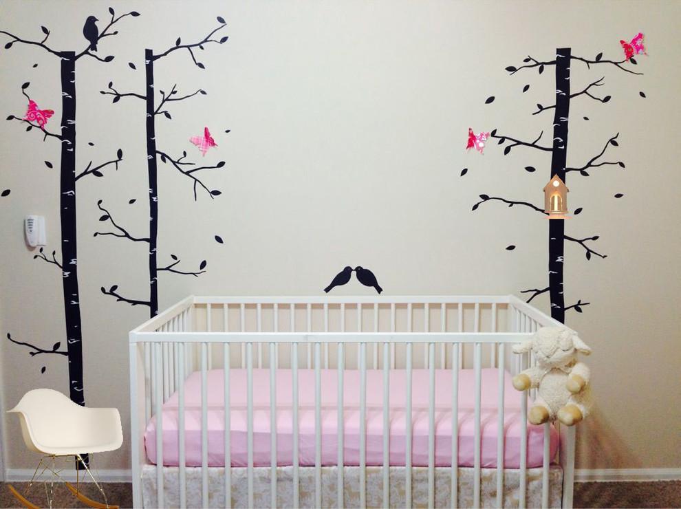 Nursery - small transitional girl nursery idea in Denver with beige walls