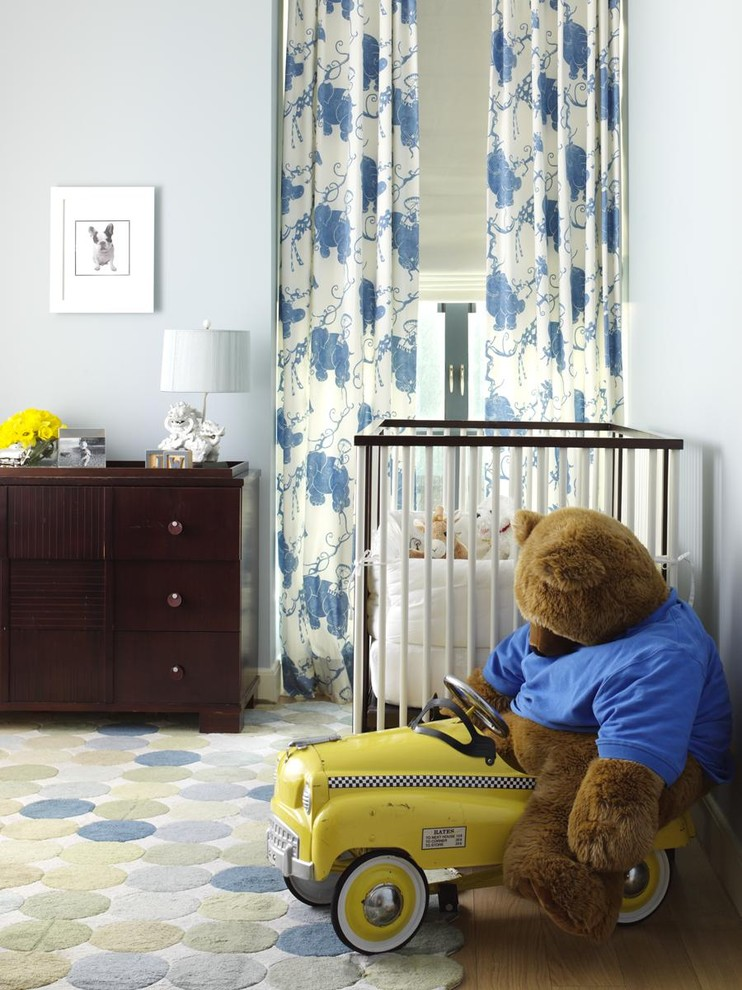 Example of a classic gender-neutral nursery design in New York with blue walls