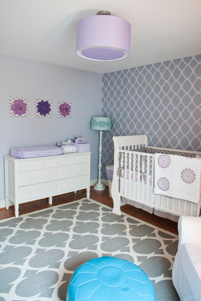 Mid-sized transitional medium tone wood floor nursery photo in Richmond with purple walls