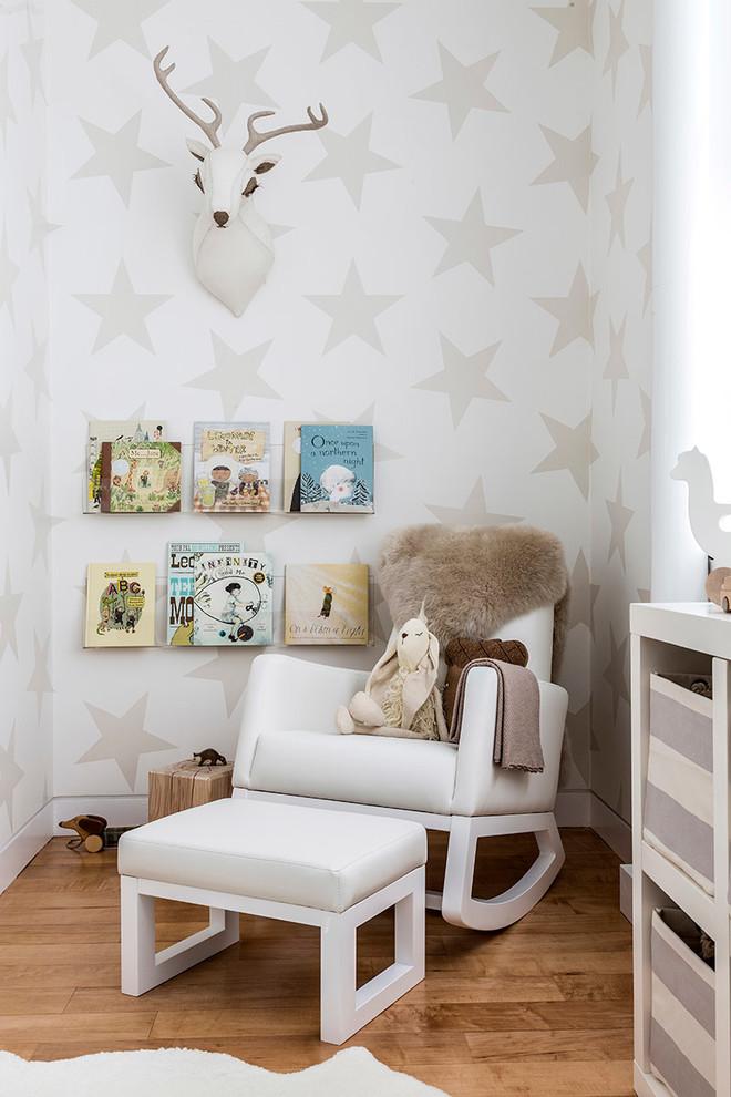 Nursery - contemporary gender-neutral light wood floor nursery idea in New York with multicolored walls
