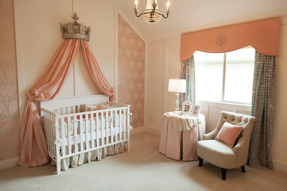 Example of a classic girl carpeted and beige floor nursery design in Dallas with pink walls