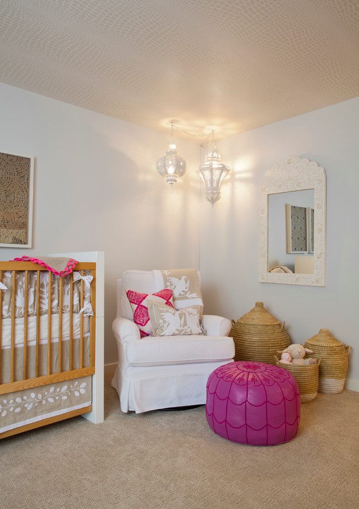 Example of a mid-sized trendy girl carpeted nursery design in Miami with blue walls