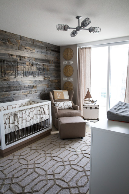 Small rustic gender neutral nursery in New York with grey walls.