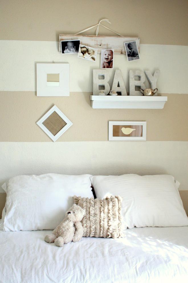 Elegant gender-neutral nursery photo in Dallas with beige walls