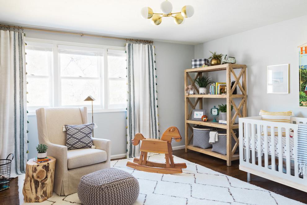 Example of a beach style brown floor nursery design in Boston