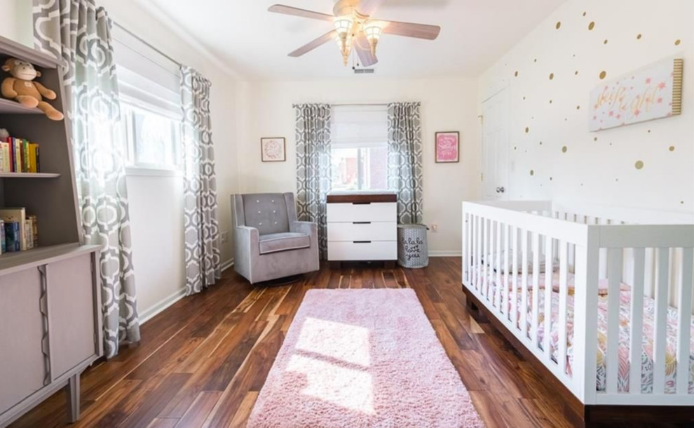 Example of a large minimalist girl medium tone wood floor and brown floor nursery design in Indianapolis with white walls