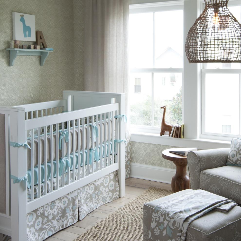 Example of a transitional gender-neutral light wood floor nursery design in Atlanta with beige walls