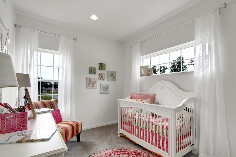 Example of a mid-sized transitional girl carpeted and gray floor nursery design in Philadelphia with white walls