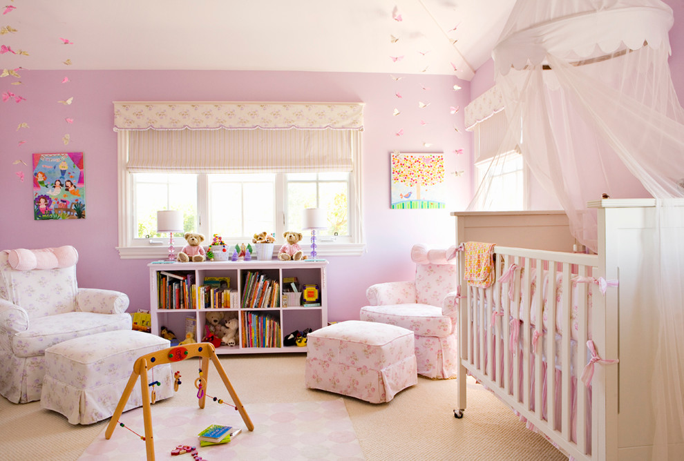 Nursery - large traditional girl carpeted nursery idea in Los Angeles with pink walls