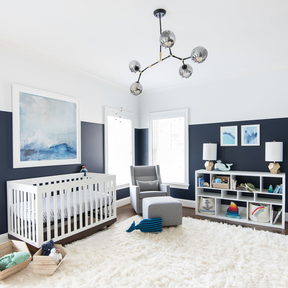 Example of a transitional gender-neutral dark wood floor and white floor nursery design in DC Metro with blue walls