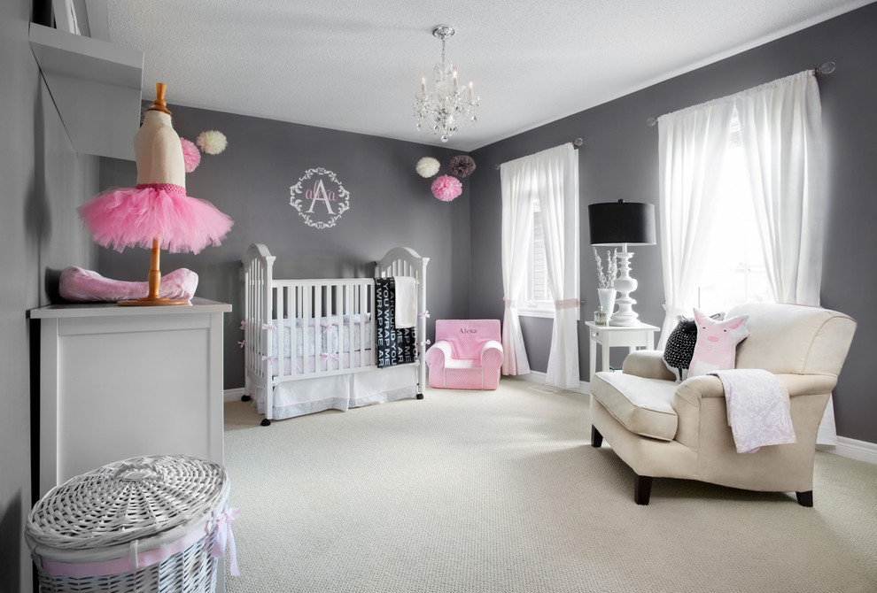 Large transitional girl carpeted nursery photo in Toronto with gray walls