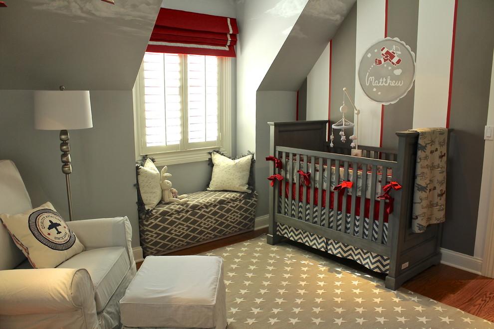 Nursery - small transitional boy medium tone wood floor nursery idea in Chicago with multicolored walls