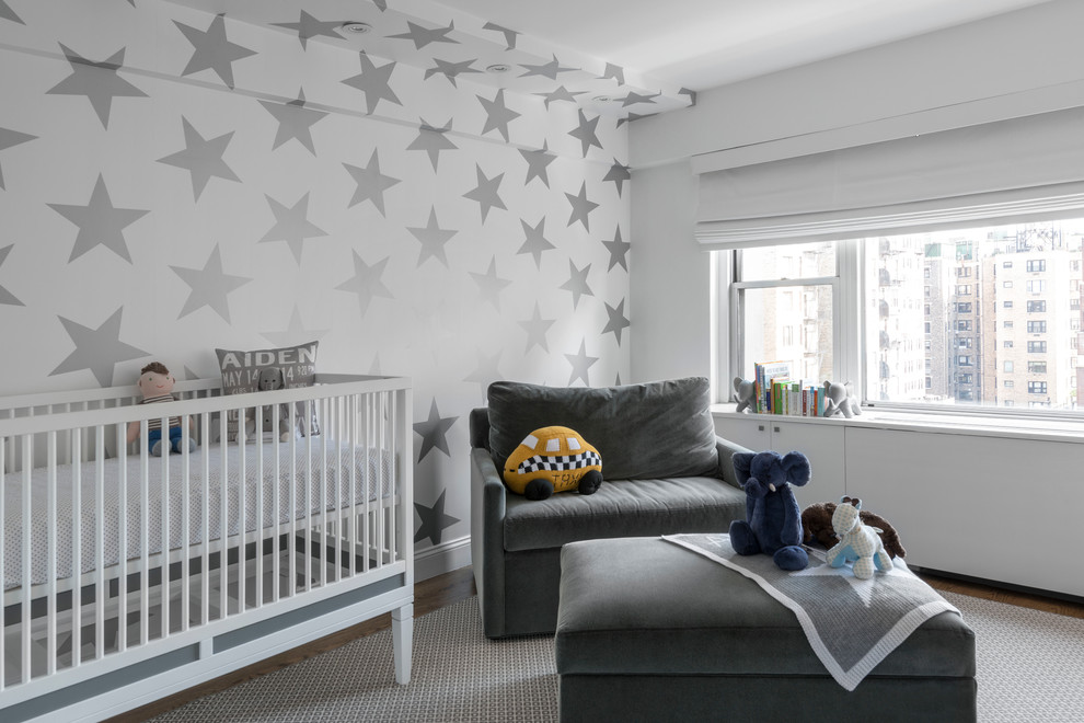 Nursery - mid-sized contemporary gender-neutral medium tone wood floor and gray floor nursery idea in New York with multicolored walls