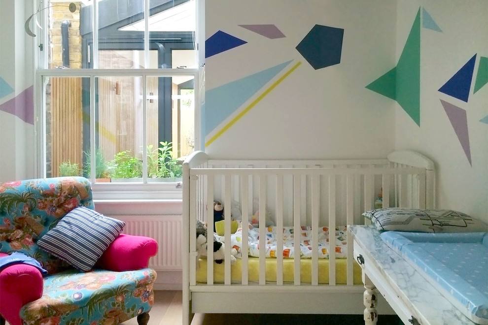 Inspiration for a small contemporary gender-neutral nursery remodel in London with multicolored walls