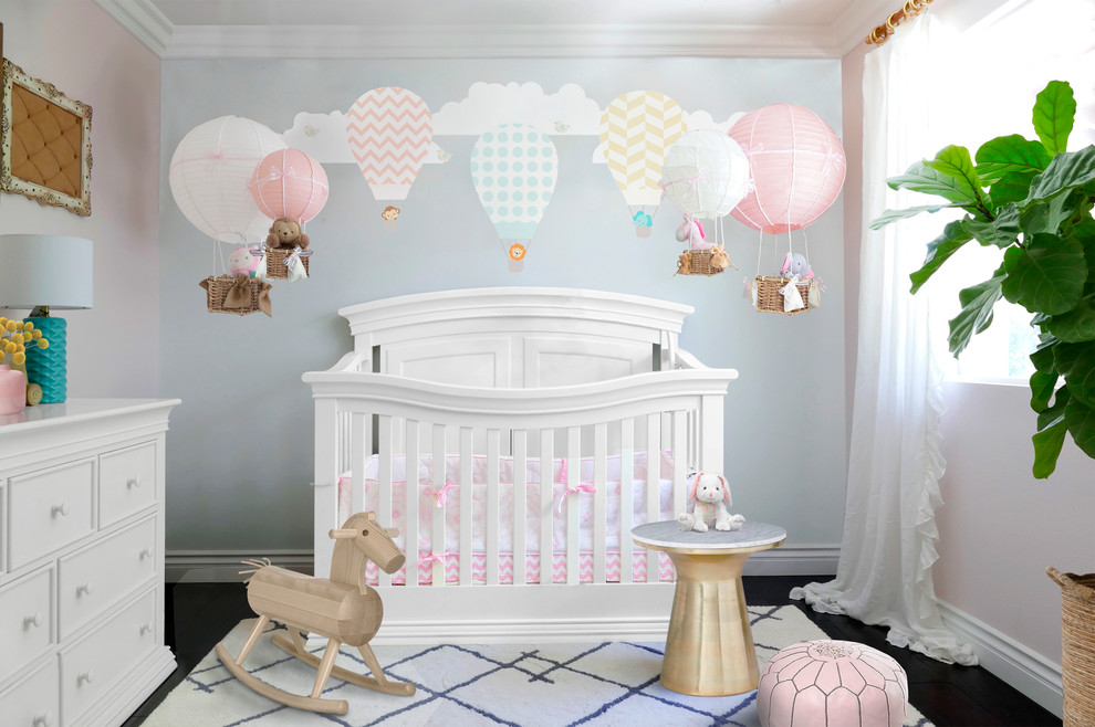 Nursery - mid-sized transitional girl nursery idea in Orange County with pink walls